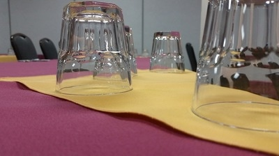Drink glasses and napkins on meeting room table